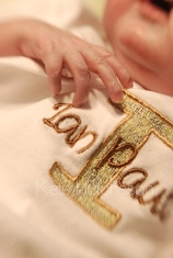 Ian's hand next to embroidered name