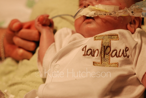 Ian holding Daddy's finger