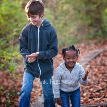 kids throwing leaves at the camera