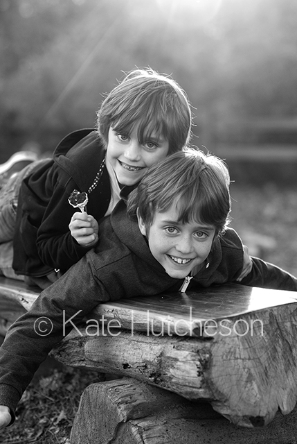 two boys in the sunlight, black and white