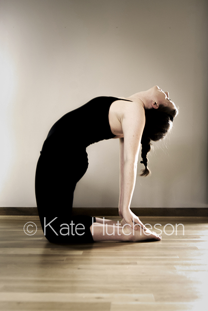 yoga instructor in a deep backbend