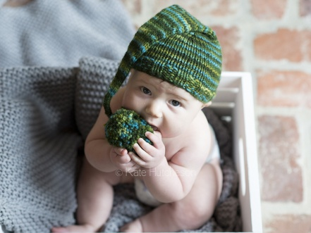 baby eating hat